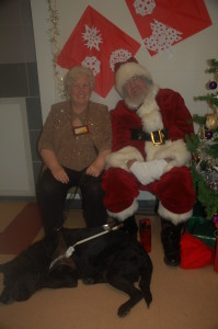Sparkly Lee and Ed the guide dog happily posing for Santa