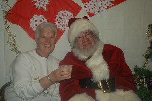 June is happily cheering Santa with some yummy eggnog