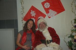 A joyful Executive Director Barbara Runco celebrates with Santa