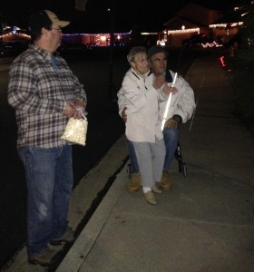 The residents of Starlight Circle were kind enough to offer snacks and drinks throughout the walk. Here Claude and Madaline are sharing hot kettle corn with Jim while waiting for Terry and Joey to get fresh lumpia.